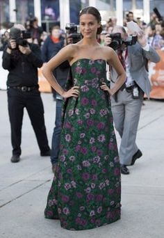 Alicia Vikander Newcomer Alicia Vikander made a strong entrance at the The Fifth Estate premiere in a bold floral print. The best part of this floor length look is the sheet of fabric that cooly acts