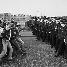This is an image from the British Miners' Strike of 1984-1985. On March 6, 1984, the Thatcher government announced plans to immediately begin closing 20 coal mines, and its intentions to eventually close over 70 more pits. Following the announcement, miners led by the National Union of Mineworkers participated in mass walk-outs and strikes, including the famous Battle of Orgreave.  Photo credit: John Sturrock
