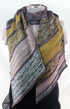 Elevation is a wrap that will cocoon you in comfort. While the stitch patterns are simple, the color and pattern changes will keep you knitting, excited to get to the next section. There are so many options for you to change the colors, you can knit several of these luscious wraps and each will have a different look.