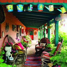40 ideas for patios. South-of-the-border style patio. Willow chairs invite lounging on this large front porch, which doubles as a gallery for a festive collection of Mexican artifacts.
