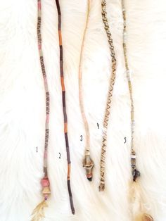 These handmade dreadfalls are elegantly primal. They reflect a tribal, boho aesthetic and are each crafted with care from many natural elements, including leather, clay beads, wooden beads, feathers, sinew, and thread. Theyre easy to wear for temporary use at a festival, simply use a rubber band or bobby pin to attach the end to either the root of a braid. If you already have dreadlocks, theyre high quality and long-lasting enough to be a permanent addition to your lovely locks, just one in…