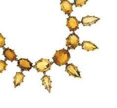 A 19th century gold and citrine festoon necklace Composed of a series of graduated collet-set oval mixed-cut citrines with bead decoration, suspending nine pear-shaped citrine drops, circa 1870
