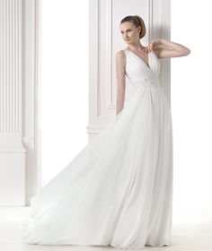 The New Design Greek-inspired wedding dress in gauze and tulle. Princess style. Draped V-neck bodice with gemstone embroidery at the waist and shoulders. Sheer, embroidered back with gemstone embroidery.  Free Measurement