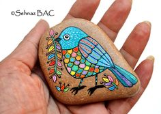 Hand Painted Stone Bird Beach Stone with hand-painted designs in acrylics  © Sehnaz Bac 2014    I paint and draw all of my original designs by hand with the small brushes or paint pens with extra fine tip. I use also isographs with different inks. No stencils are used. All designs are created with my imagination.    These pebbles were found on the beaches of Adriatic Sea. Each was chosen for its shape, smoothness and uniformity. They are protected with 2 or 3 layers of high quality glossy…