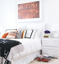 Nothing like bright natural light, white lacquered night stands and a Hermes throw.