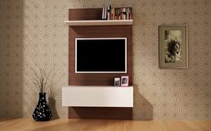 Liked 1. Wall color and pattern 2. Tv cabinet