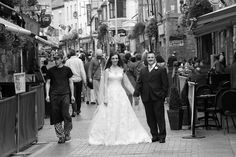 The couple standing in the Shop Street