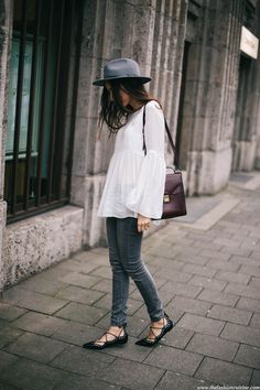 Fashion blogger Beatrice Gutu wearing Zara lace up flats with white bell sleeve top and grey fedora hat