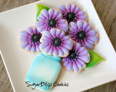 Shades of purple flowers, leaves, and blue canning jar cookies by SugarBliss Cookies
