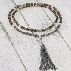 Featured Stones: Labradorite, Rose Quartz, Smoky Quartz The pattern of 11 was used when crafting this mala and it represents intuition and revelation. It enhanc Elastic Thread, Smokey Quartz, Heart Chakra, Intuition, Rose Quartz, Labradorite, Tassel Necklace, Gemstones, Pattern