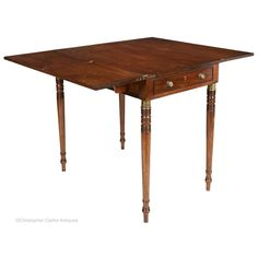 A mahogany Georgian Campaign Table with hinged leaves. The table has a single, full length drawer and a pair of lopers to each side to support the leaves when the table is extended to double its width. When folded the leaves rest on the table top. Stow On The Wold, Campaign Furniture, England Fashion, Georgian, Drawers, Dining, Storage, Table
