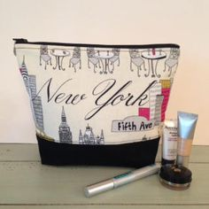 A personal favorite from my Etsy shop https://www.etsy.com/listing/534849565/new-york-makeup-bag-large-cosmetic-bag-i