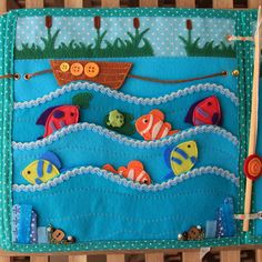 I really like the layout of this page, with cattails on top :) The fish all come out of the waves, maybe attach them with string? Love how the boat moves on the leather string.