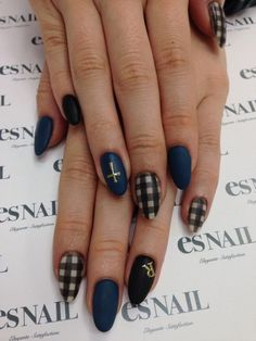 Elegant looking gingham nail art design in gray, black, blue and gold color combinations. The matte and stripes give a great look on the nails as well as the gold letter accent on top.