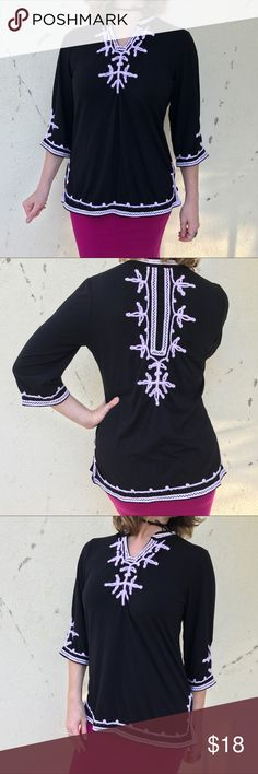"""Lauren Michelle Black TUNIC WHITE TRIM TOP L/XL Black tunic by Lauren Michelle! Known for her embellished bold tops, she designs a striking top with white embroidery accents on front and back! 3/4 sleeves a d notched neckline. 27"""" long, bust 19"""" flat across with more stretch!  Poly/rayon/spandex. Marked as an XL, fits more of a Large. lauren michelle Tops Tunics"""