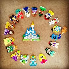 Disney characters perler beads by Saya Ono - could make it into a watch. Cute for kids bedroom. Melty Bead Patterns, Pearler Bead Patterns, Perler Patterns, Beading Patterns, Quilt Patterns, Hama Beads Design, Diy Perler Beads, Perler Bead Art, Pearler Beads
