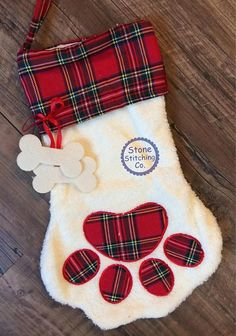 Such a cute dog stocking! Love the little fluffy  paw with the plaid and  bones!      Personalized dog stocking, dog christmas stocking, monogrammed dog stocking, Affiliate