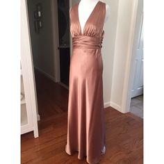 Bronze prom or pageant gown Beautiful cocoa/bronze prom gown! Is a size 10 on tag, but has been taken in to a 4/6. Original seam is intact so can be let out. Open back is so gorgeous!! Barijay Dresses Prom