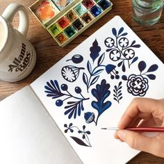 Hand painted watercolor flowers by kristensevig. Cobalt blue flowers in a watercolor sketchbook.