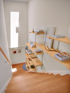 stair step bookcase stairs shelves books painting white walls modern staircase of The Best Stair Step Bookcase Combos to be in Awe Of Track Shelving, Modular Shelving, Shelving Systems, Adjustable Shelving, Step Bookcase, Staircase Shelves, Modern Staircase, Cottage Staircase, Plywood Shelves