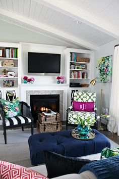 I love everything about this living room - I wish I had the ability to make a room look so fun and vibrant!  Lots of colors and different textures