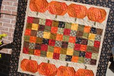 Pumpkin Patch Table Topper pieced and quilted by Leisha Farnsworth.  Another version of the Pumpkin Patch Quilt pattern by Kimberbell.