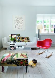 White washed floors teamed with colourful pieces to bring life to the room.