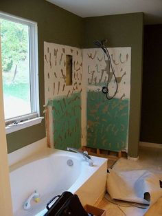 builder s grade bathroom turned to showcase space, bathroom ideas, home decor, home improvement, The cultured marble wall panels and base were leaking and removed