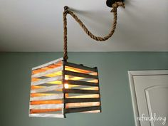 Use an old egg crate to create a unique DIY farmhouse style light fixture. A vintage Edison style bulb and a DIY rope pendant cord adds to the rustic charm! Pendent Lighting, Crates, Pendant Light Kit, Light Fixtures, Egg Crates, Farmhouse Light Fixtures, Pendant Light, Light, Diy Lighting
