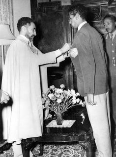 Abebe Bikila is awarded by Emperor Haile Selassie, after returning victorious from Rome Olympic Games