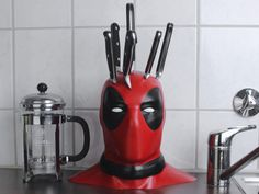 There's no question about how much we all loved Deadpool. So, why not add some Deadpool knife block to you kitchen? We guarantee this is probably the best knife block we've ever seen. Geek Decor, Geek Culture, Knife Holder, Tv Holder, Geek Gadgets, Knife Block, Kitchen Gadgets, Geek Stuff, Cool Stuff