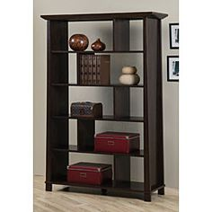 Andaman bookcase is sure to enrich your home decor with Asian flair Living room furniture showcases a light Halifax brown finish Bookcase features five shelves for storage or display