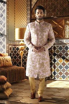 PINK RAW SILK SHERWANI A splash of splendour! Look imperial in this regal raw silk sherwani in pink .The perfect look is created by the overall heavy embroidery & can be carried off with panache at your wedding functions. Sherwani For Boys, Sherwani For Men Wedding, Wedding Dresses Men Indian, Sherwani Groom, Couple Wedding Dress, Groom Wedding Dress, Groom Dress, Indian Groom Wear, Mens Kurta Designs