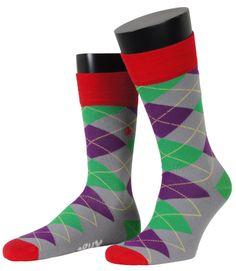 Bunter gehts nicht! Unabux Socken sollen auffallen - und das schaffen sie auch, mit knalligen Farben und Mustern, die gute Laune verbreiten. Argyle Muster in den Farben Lila und Grün, auf grauem Grund. Für weitere Infos: http://www.boxxers.de/Unabux-Socke-Argyle-grau-020_1