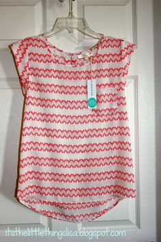 I love the style and pattern of this shirt. I would prefer a different color than red. super cute!