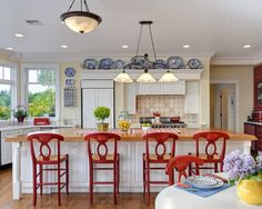 There it is!!!  Right down to the blue and white dishes and red accents!  My imaginary kitchen.... turn island to overlook river though windows above kitchen sink.