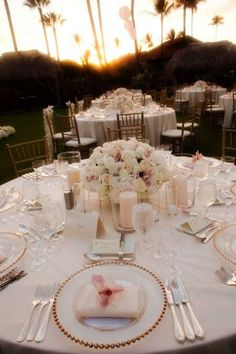 Love the flower centerpiece with hurricane vases + candles around it...flowers AND candles, you can't go wrong