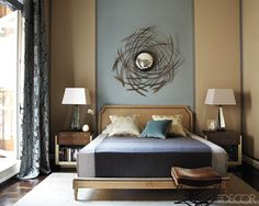 The walls of the master bedroom are outlined with ribbon trim from Mokuba, and  the curtains are of a Jim Thompson silk; shagreen-and-parchment tables flank a Collection Pierre bed upholstered in a Jim Thompson fabric, and the mirror is by Hervé Van der Straeten.