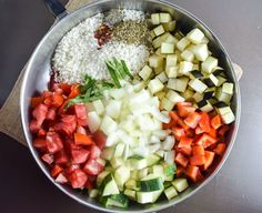 One pot showing all ingredients - red bell pepper, zucchini, roma tomatoes, white onion, eggplant, rice, and seasonings with basil chiffonade