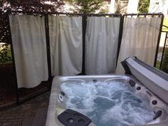 Curtain privacy screen made from PVC pipe and outdoor fabric - Bless Your Heart: DIY privacy screen