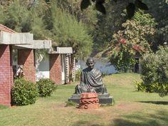 Sabarmati Ashram (Gujarati: સાબરમતી આશ્રમ also known as Gandhi Ashram, Harijan Ashram, or Satyagraha Ashram) is located in the Sabarmati suburb of Ahmedabad adjoining to famous Ashram Road, at the bank of River Sabarmati, 4 miles from the town hall. This was one of the residences of Mohandas Karamchand Gandhi. Mahatma Gandhi spent approximately 12 years of his life here.