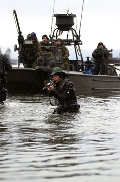A member of SEAL Team 5 covers his team mates as they are extracted by members of Navy Special Boat Unit 22