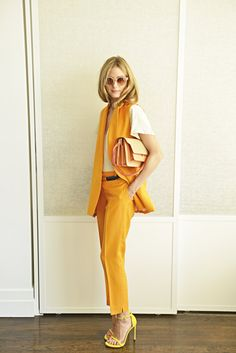 wearing vintage sunglasses, Paul & Joe suit, Daryl K t-shirt, Stuart Weitzman shoes, Whistles belt, and Marni bag.