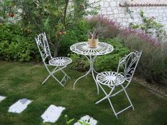 White wrought iron table and chairs for the garden