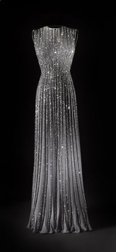 pleated chiffon gown with beading. so if I ever win an award, loose 20 lbs, and begin to look good in grey, I am sooooo buying this..