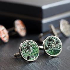 These sharp and modern cufflinks, made of stainless steel and circuit board piece, will become an impressive addition to your look. It will win the Christmas as a perfect unique gift for a techie geek in your life! The cufflinks are 6/8 (18 mm) in diameter. They are made of real circuit boards from old computers and so far we offer 8 colors: - blue - dark blue - red - green - purple - black/ brown - yellow / olive green - orange You will receive one similar to those you see on ...