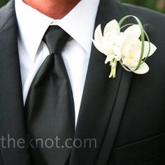 White Orchid Boutonniere- this is what I'm doing now if only I could figure out how to make it look cute like this!!
