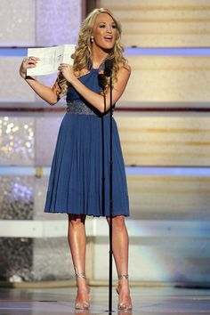 Carrie Underwood Photos Photos - Musician Carrie Underwood presents the award for top new female vocalist onstage at the 42nd Annual Academy Of Country Music Awards held at the MGM Grand Garden Arena on May 15, 2007 in Las Vegas, Nevada. - 42nd Annual Academy Of Country Music Awards - Show