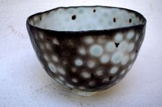 Priscilla Mouritzen, Pinched bowl 4, Spots of celadon glaze act as a resist to carbon trapping
