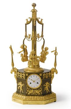 A rare Empire ormolu and patinated bronze automaton carousel clock, attributed to Vaillant à Paris<br><P>circa 1810</P> | Lot | Sotheby's